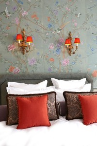 Image of bedroom with wall papered in Chinoiserie wallpaper in green and orage