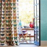Curtains in butterfly design fabric on white fabric