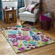 Floral Rug in shades of purple green and turquoise against a white background