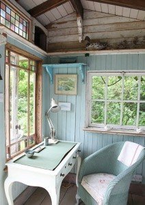 Interior of shed with desk and chair