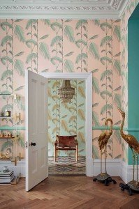 Dramatic wallpaper with palm leaves against a blush pink background