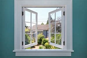 Image of an open window with vieiw on to a garden