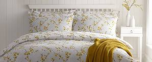 Image of bedding white with yellow and grey floral design