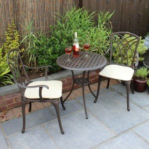 Image of a bistro garden set on patio with wine glasses and bottle of wine