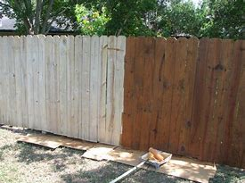 Image of a fence half painted