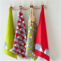Image of tea towels hanging on pegs